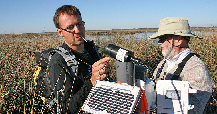 Francesco Peri and Bernie Gardner check remote real-time sensors in Snipe Creek, Florida.